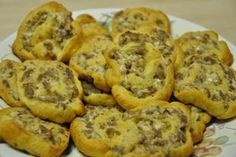 So easy.  Crescent rolls, sausage and cream cheese. These are the MOST delicious things!-make it real easy and use jimmy dean sausage crumbles