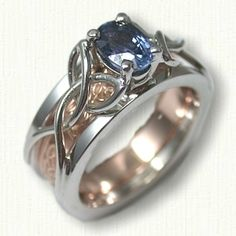 Open Wire Vanessa Reverse Cradle set with a 1.0ct oval blue/purple sapphire