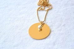 Large Hand stamped Gold Disc Necklace with a Pearl by DriftByAllie, $50.00