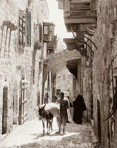 This picture was taken in Jerusalem in the early 1900's. It shows station 5 on the Via Dolorosa, or Way of Suffering. It is the path, tradition says, that Christ took on the way to the crucification.