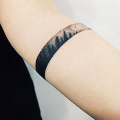 Dotwork style armband tattoo of a forest. Tattoo artist: Doy