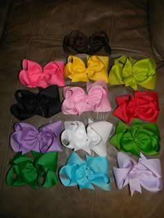 *The HaNnAh GrAcE Special*   13-- 6 inch bows (made with 2 1/4 inch ribbon) You choose from barrette or lined alligator clip   **Brown, Hot Pink, Yellow, Lime Green, Black, Light Pink, Red, Purple, White, Apple Green, Emerald Green, Aqua & Lavender**  If you were to buy each of these bows separately, it would cost $97.50 ($7.50 per bow) Buy them ALL for $75 (plus shipping if you need them shipped) ©2011Hairbows*N*More Find me on Facebook! Hairbows N More