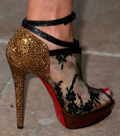Gold and black shoes with red sole