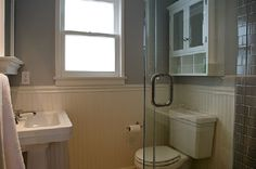 Small space bathroom.  Perfect for basement remodel. Pedestal sink, beadboard, frameless shower doors