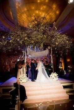 Enjoy your wedding ceremony in our Grand Ballroom. Photos by John Solano