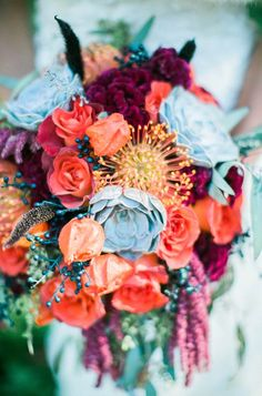 Lush Wedding Bouquet Featuring: Red-Violet Celosia (Coxcomb), Gray Succulents, Coral Roses, Coral Pin Cushion Protea, Red Amaranthus, Dark Blue Berries, Greenery/Foliage