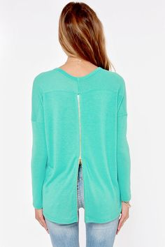 Did your heart just skip a beat? The Zip to My Lou Teal Sweater Top has been known to have that effect! Soft teal green knit is just what you need, with long sleeves, a splendid scoop neck, and a high-low hem. An exposed zipper down the back adds a little edgy appeal in shiny gold.