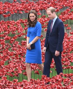 Kate Middleton and Prince William walking among flowers