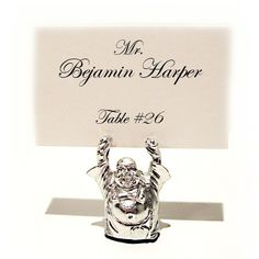 """Looking for a unique placecard holder? Look no further! Our Buddha placecard holders will be a hit at any event. Each placecard holders is silver plated and measures approx.: 1 3/4"""" x 2"""".  #weddingfavor #buddha #placecard"""