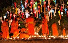 Colourful Ritual A group of monks take part in a candle lighting ritual on New Year's Eve in Chiang Mai, Thailand.