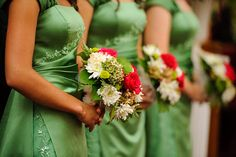 Hideous dresses, but I like how the flowers contrast and combine the colour of the dresses