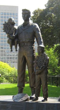 "The Canadian Memorial Statue (2001) was erected by Canadian Veterans of the Korean War. The memorial statue consists of two children being carried by a soldier; each child is holding 21 hibiscus and maple leaves represent the 21 Canadian MIAs in the war. The name of the each fallen Canadian soldier is placed at the base of the memorial along with epitaph ""We will never forget you brave sons of Canada""."