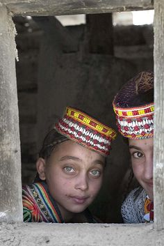 Children of Kalash tribe in Kalash valley in N. Pakistan. A major attraction of Chitral are the Kalash valleys, home of the Kafir-Kalash or 'Wearers of the Black Robes', a primitive pagan tribe. Their ancestry is enveloped in mystery & is the subject of controversy. Legend says five soldiers of the legions of Alexander of Macedonia settled in Chitral & are the progenitors of the Kafir-Kalash. The Kalash women wear black gowns of coarse cloth in summer & hand-spun wool dyed in black in…