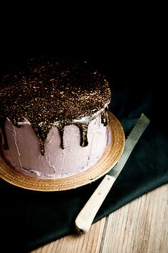Make an Oreo olallieberry chocolate layer cake with gold flake toppping. / 43 DIY Ways To Add Some Much-Needed Sparkle To Your Life (via BuzzFeed)