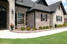 Brick House Exterior Discover Top 50 Best Brick And Stone Exterior Ideas - Cladding Designs From rustic to contemporary discover outdoor appeal with the top 50 best brick and stone exterior ideas. Café Exterior, Stone Exterior Houses, Exterior House Colors, Exterior Design, Brown Brick Exterior, Brick Exteriors, Rustic Brick House Exterior, Austin Stone Exterior, Stone Houses