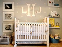 Like the large black and white photos on the side of the crib. Also love the large monogram letters!  And shelves.  Okay, love the whole thing.