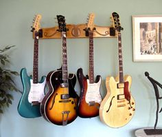 The Best Guitar Storage Solutions For Your Home or Studio. Beautiful and Space-Saving Guitar Stands, Racks, Wall-Mounts and More. Guitar Hanger, Guitar Wall, Guitar Room, Cool Guitar, Guitar Storage, Guitar Display, Ukulele Stand, Home Music Rooms, Gun Rooms