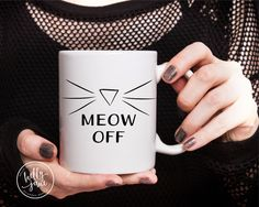 The Meow Off mug. The sophisticated way to let everyone know they need to wait until youve had your coffee... or whatever it is that youre hiding in that mug.