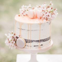 Simple yet gorgeous love this soft semi-naked cake with flowers & macarons…