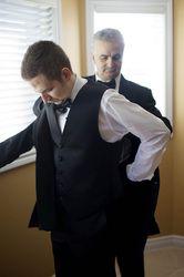 Groom putting on tuxedo jacket.  #torontoweddingphotography #torontoweddingvideography #weddingphotography #torontoweddings #torontowedding #culturalwedding #torontophotographer #torontovideographer #weddingvideography #torontobride