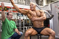 "Author Doug Brignole teaching rising bodybuilding star Sam Schrader how to perform ""Lat Pull-Ins"". Great article in Iron Man magazine :) Doug doesn't just tell you how to do something, he tells you WHY you should!!!"