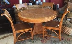 """Lexington rattan dining set. Cheerful table and chairs for dining room or kitchen start with classical form and re-interpret them in bamboo and split cane for a light, tropical and elegant look. Table 48"""" diameter. 4 sunburst side chairs 22"""" x 24"""" x 37"""""""