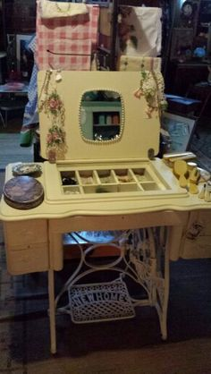 Vintage treadle sewing machine repurposed into a vanity.