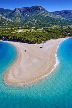 Zlatni Rat Beach, Croatia.    Located on the southern coast of Brac Island, Zlatni Rat Beach is nicknamed the Golden Horn for its unusual shape that juts out into the Adriatic Sea.