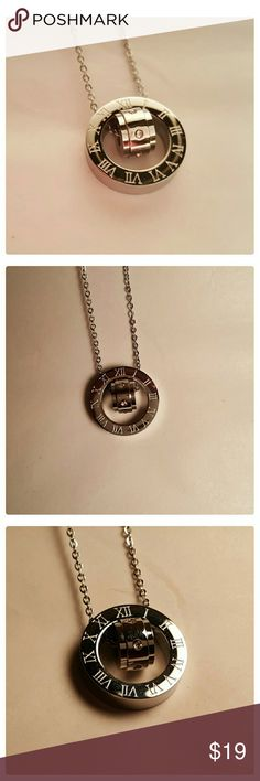 Silver Roman Numeral crystal Pendant necklace NWT Stainless steel pendant with roman numerals and inner crystal circle. Available in silver or rose gold colors. Pendant: 2 cm. Chain aprox : 18 in.  ***Only 1 available in each color*** Jewelry Necklaces