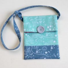 The first time I saw this line of fabric, I knew just what I wanted to make with it. A fun, simple, portable bag that would be love...