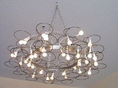 MATTRESS CHANDELIER by Claudia | Please subscribe to my weekly newsletter at upcycledzine.com ! #upcycle