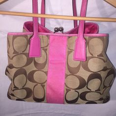 Authentic Coach Pink And Brown Signature Handbag Authentic Coach Pink And Brown Signature Handbag Size 13.5x10   Great Condition! Needs to be cleaned up a little, but you can buy the Coach cleaner in store or online at Coach.com for $10. Coach Bags Satchels
