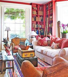 Vintage leather chairs with reupholstered cushions lend a casual, comfortable air to this library. - Traditional Home ® / Photo: Dominic Blackmore / Design: Su harr