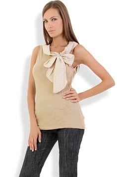Abbigliamento da Donna  http://www.abbigliamentodadonna.it/maglietta-senza-maniche-fiocco-p-659.html  Cod.Art.000742 - Maglietta senza maniche con fiocco dotata di ampio e comodo scollo tonto per una donna fashion e sempre alla moda.