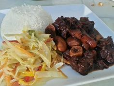 one of the best jamaican oxtail recipes served with plain rice and stir fry cabbage. - YouTube
