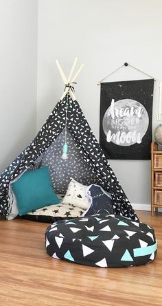 A printed reading nook with a tipi/