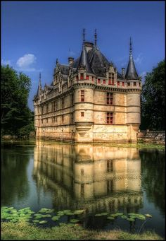 France:Azay le Rideau, France - A small romantic castle located in the Loire Valley and represents one of the most successful examples of Italianate architecture in the Touraine region. Its unrivaled elegance and the richness of its furniture alone are worth the visit.
