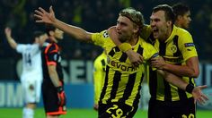 Marcel Schmelzer celebrates his game winning goal for Dortmund with teammate Kevin Grosskreutz.  Dortmund defeated Real Madrid 2-1  in their UEFA Champions League group stage match.
