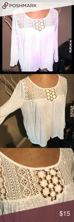 Lace top by American Eagle 🦅 Cream colored crinkle textured top by American Eagle outfitters. Cotton and polyester. Embroidery across top and cut out on back. Looser fit. So cute! NWOT, never worn! American Eagle Outfitters Tops Tees - Long Sleeve