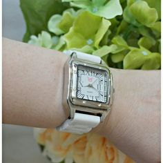 """Encore JustFab watch. Elegant watch in cool colors. Face with white background, lines, indicating numbers, are in black and very easy to read, 12, 3, 6, and 9 numbers are silver. Silver color sophisticated frame, with two rhinestones on each side. White rubber band.  Details: face H 1-1/2"""" x W 1-3/8"""". Total band / watch length 9"""", working battery. I have small wrist.   Please use only ✔OFFER  button for all price negotiations. I'll do a price drop⤵ for discounted shipping, if we agree about…"""