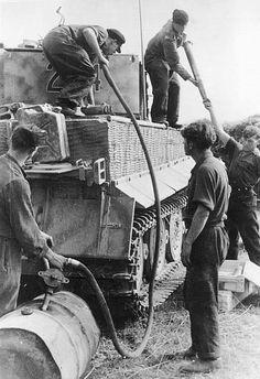 Image result for ww2 German fueling up tank  the ardennes