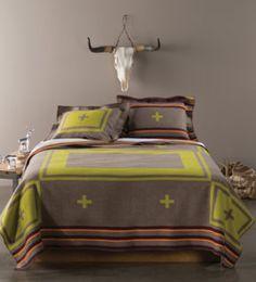 Navajo inspired bedding by Pendleton. Love the modern twist!