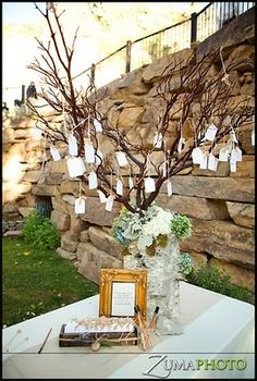 Guests leave their wishes for the bride and groom on a Sign-In Tree, cute :)