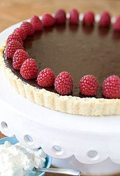 Bittersweet Chocolate Tart w/ Raspberries  :fantastic with a spiced or salted tart shell.
