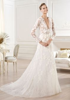 Chantilly lace dress with crystal precious stones and organza flower appliqués.