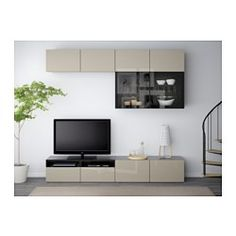 IKEA - BESTÅ, TV storage combination/glass doors, black-brown/Selsviken high gloss/black smoked glass, drawer runner, soft-closing, , The drawers and doors have integrated push-openers, so you don't need handles or knobs and can open them with just a light push.The space-saving wall cabinets make the most of the wall area above your TV.It's easy to keep the cords from your TV and other devices out of sight but close at hand, as there are several cord outlets at the back of the TV bench.The…