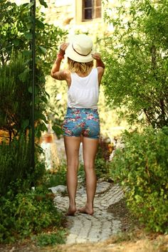 Floral short shorts and a straw cap. Begin summer begin.