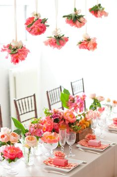 I like the idea of hanging the bridal party bouquets over the head table. Side note if head table was round under tent, I would have table centered in the venue with guest tables around it, withe flowers above.