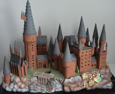 Hogwarts Cake. Gingerbread house. Gingerbread castle. Castle cake. This cake is approximately 60 by 120 cms and was made using gingerbread, cake, Rice Krispies Treats, ice cream cones, and 36 kgs of fondant.