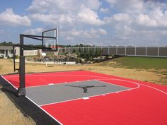 Backyard half basketball court with custom logo, built by DeShayes Dream Courts